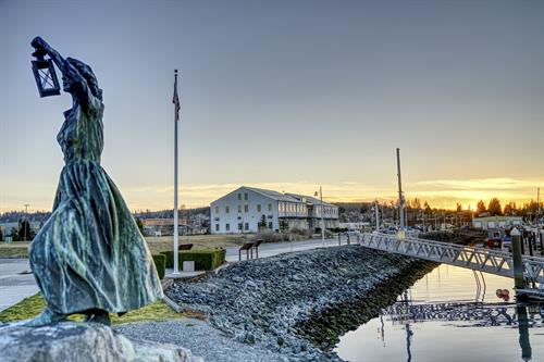A statue at the Anacortes Marina sits in front of the new Samish HHS building.