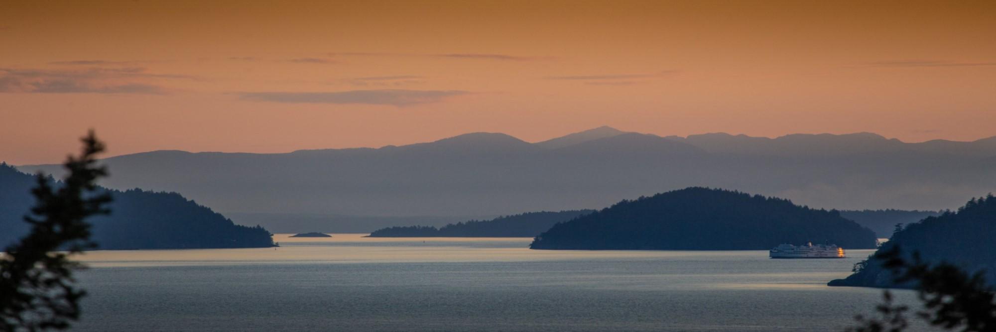 San Juan Islands with sunset over the cascade mountains